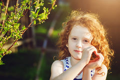 Sunny girl folded her hands a heart shaped. Background toning for instagram filter Stock Photos