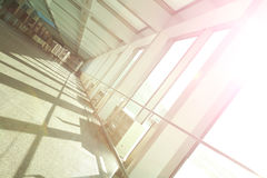 Sunny on glass office building interior corridor. Sunny on modern glass office building interior corridor Royalty Free Stock Photo