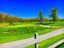 Sunny Golf Course. A picturesque golf course in bright sunlight Royalty Free Stock Photography