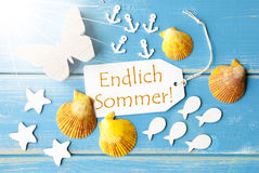 Sunny Greeting Card With Endlich Sommer Means Happy Summer. Flat Lay View Of Label With German Text Endlich Sommer Means Happy Summer. Sunny Summer Greeting Card Stock Photo