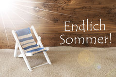 Sunny Greeting Card, Endlich Sommer Means Happy Summer. Sunny Summer Greeting Card With Sand And Aged Wooden Background. German Text Endlich Sommer Means Happy royalty free stock images