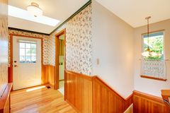 Sunny hallway staircase front door and warm wood. royalty free stock image