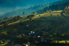 Sunny hills in Transylvania. Sunrise in a village of Transylvania, Romania Stock Photography