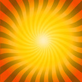 Sunny Hot Burst. Orange, yellow and black bright burst of twirling rays with lots of copyspace in the middle makes  a vivid background design Stock Photos