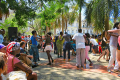 Sunny and hot cuban salsa in the square of Havana. Cuba, Havana - 07 April, 2016: street dances of salsa in one of the central squares in Havana, where both the Stock Photo
