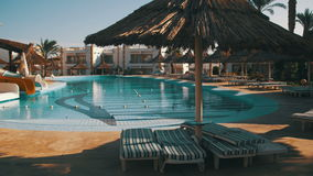 Sunny Hotel Resort with Blue Pool, Palm Trees and Sunbeds in Egypt stock video