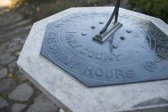 Sunny Hours Sundial. A sundial that is awaiting the sun that states on it, 'I only count the sunny hours Stock Images
