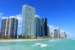 Sunny Island Beach with skyscraper royalty free stock image