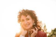 Sunny joyful mature woman portrait Stock Photo