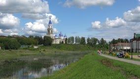 Sunny July day on the bank of the Kashinka river. Kashin, Russia. KASHIN, RUSSIA - JULY 13, 2019: Sunny July day on the bank of the Kashinka river stock footage
