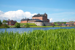 Sunny June day on the Vanajavesi lake. View of the old fortress of Hameenlinna, Finland Royalty Free Stock Photography