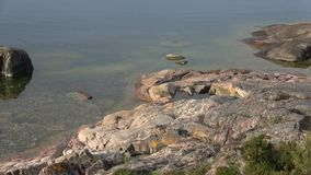 On a sunny june morning on the cliffs of the Peninsula of Hanko, Finland stock video footage
