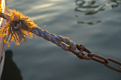 The Sunny Knot. The rope and the chain, holding the boat on the quay Stock Images