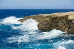 Malta, Gozo island coastline, wild waves and rocks, blue sky - sea horizon Royalty Free Stock Photo
