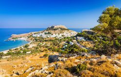 Sunny landscape of Lindos village with ancient castle Royalty Free Stock Image
