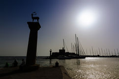 Sunny landscape of mandraki harbor with Deer Statue Royalty Free Stock Photography