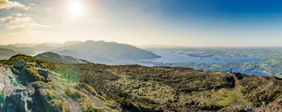 Sunny landscape panorama form top of the Torc mountain in Ireland. Beautiful sunny panorama of irish mountain landscape. Killarney, Ring of Kerry, from Torc Royalty Free Stock Photo