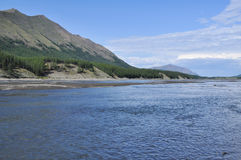 Sunny landscape of the river in mountains. Stock Image