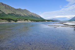 Sunny landscape of the river in mountains. Royalty Free Stock Image