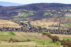 Sunny landscape of a small village from slightly above Royalty Free Stock Photo