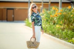 Sunny lifestyle fashion portrait of young stylish hipster woman walking,oung pretty woman outdoor summer portrait.Close royalty free stock photo