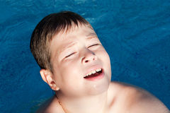 Sunny little boy swiming Stock Image