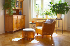 Sunny living room wicker chair Stock Photos