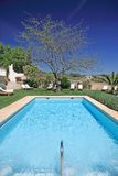 Sunny, luxury swimming pool in Spain Royalty Free Stock Photo