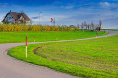Sunny meadow with lonely path Stock Photography