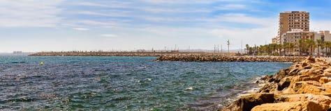 Sunny Mediterranean beach, relax in ocean, Torrevieja, Spain Royalty Free Stock Images