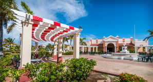 Sunny mid-day in Varadero, Cuba.  Coloruful terraces at a resort hotel. - getaway on vacation in Cuba. Royalty Free Stock Image