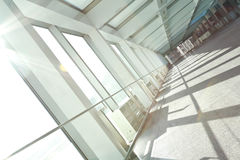 Sunny on modern glass office windows building interior corridor Royalty Free Stock Image
