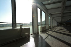 Sunny on modern glass office windows building interior corridor Stock Photography