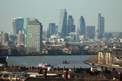 Sunny modern London landscape. Modern buildings of London.. Seen : Walky talky building, the gherkin, the cheese grater, Thames bank. Shot from Greenwich Royalty Free Stock Image
