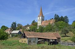 Sunny monastery. Monastery near Brasov and old traditional Transylvania village on the hill Stock Images