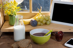 Sunny morning breakfast with digital tablet Stock Images