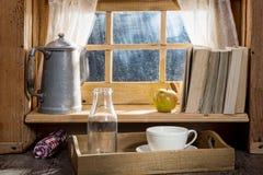 Sunny morning breakfast with milk near a window Stock Photography