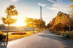 Park near the Eiffel Tower. Sunny morning and Eiffel Tower in autumn, Paris, France Royalty Free Stock Photos