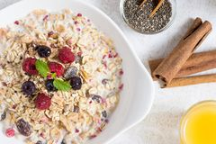 Sunny Morning with Healthy Breakfast. Muesli With Milk, Chia Seeds, Berries and Cinnamon. Healthy Breakfast on Sunny Morning. Muesli With Milk, Chia Seeds royalty free stock photos
