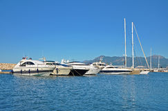 Sunny morning in the marina of Salerno with large powerboats Royalty Free Stock Photos