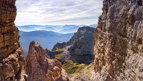 Sunny morning in the mountains. Dolomites, green valley. Alps. Via ferrata, sunny morning in the mountains. Dolomites, green valley. Alps Stock Photography