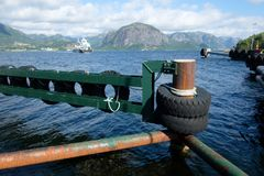Sunny morning near the ferry moorage. In norwegian village. North sea view, Norway, Europe Royalty Free Stock Photos