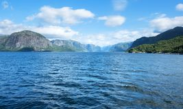 Sunny morning near the ferry moorage. In norwegian village. North sea view, Norway, Europe Stock Image