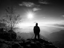 Sunny morning. Photographer preparing camera on tripod. Stock Image