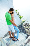 Sunny morning on the seaside. Young couple having romentic minutes on the rocky coast, sunny morning Stock Photos