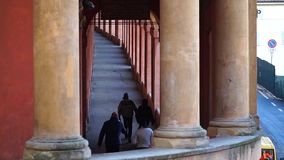 Bologna, Italy 07 January 2019: In a sunny morning some people using the famous portico to reach San Luca stock video footage