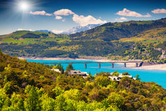 Sunny morvivg view of  lake Serre-Poncon, Alps, France. Stock Image