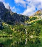 Sunny mountain landscape with lake. Mountain range above Morskie Oko Lake, Rybi Potok Valley, Tatra National Park, Poland stock photo