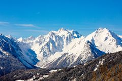Sunny mountain landscape with peaks against the blue sky royalty free stock photography