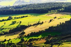 Sunny mountain valley with green fields and meadows. Scenic farmland landscape aerial view. Vast panorama of picturesque countryside in the Owl Mountains Gory Royalty Free Stock Photos